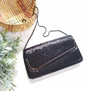 Black textured metallic clutch bag